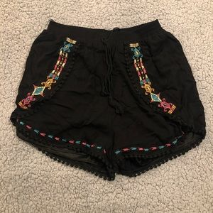 Black shorts with colorful pattern design